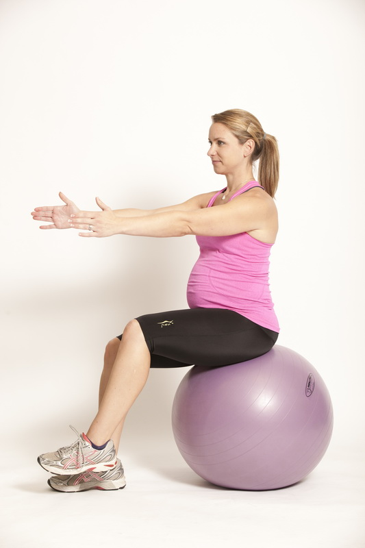 Pregnant lady on swiss ball with outstretched arms